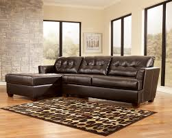 living room with bed: small black leather sectional sleeper sofa with chaise