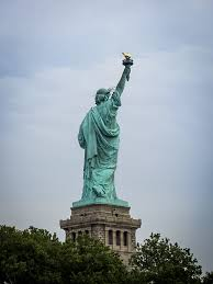 travelling tale ing the statue of liberty in new york approaching liberty island we can see the torch clearly