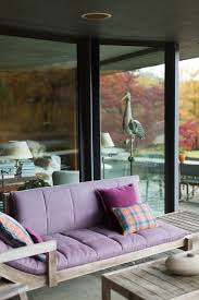 gallery outdoor living wall featuring:  patio with sofa featuring cushions made using purple sunbrella fabric and bold patterned throw pillows