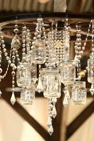1000 ideas about wagon wheel light on pinterest wheel chandelier wagon wheel chandelier and wagon wheel table alternating length wagon wheel mason jar