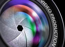 video production written on a lens of camera closeup view selective focus lens awesome office table top view shutterstock id
