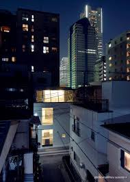 hanasaki house mono archinect the night view of the elevation that looked a high rise building group in the