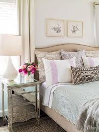 layers of neutrals such as the barely gray walls oatmeal bed and chocolate added drama mirrored bedroom furniture