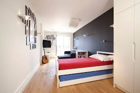 wapping e1w stylish wharf flat trendy gender neutral teen room photo in london with black walls bedroom wall lighting ideas bedroom wall lighting ideas