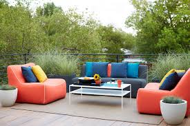 gallery outdoor living wall featuring:  oversized outdoor furniture is upholstered in red blue and yellow fabrics