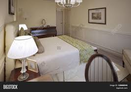 bed bedroom traditional beige wall tufted