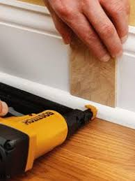 in rooms with hard flooring surfaces team base shoe molding with baseboards to cover gaps between baseboards ceiling fan