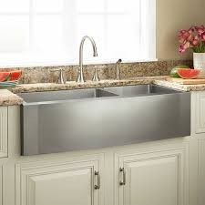 white farmhouse sink stainless steel