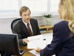 what is a resume businessman handing a resume to a businessw