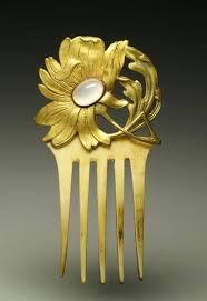 Gilt <b>bronze floral</b> motif, Art Nouveau style, ornated with an opal ...