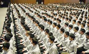 new recruits mark first day at work across the new recruits of toyota motor corp attend a ceremony friday morning at the firm s headquarters