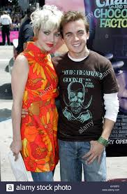 actor frankie muniz and friend jamie pose as they arrive as guests actor frankie muniz and friend jamie pose as they arrive as guests at the premiere of the new family comedy film charlie and the chocolate factory