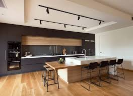 kitchen modern cabinets designs: useful items double as decor in this modern kitchen