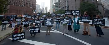 families of muslim political prisoners in the united states war metropolitan correctional center protesters hold signs the s of political prisioners from the war on terror new york city c tom martinez