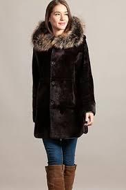 <b>Premium</b> Merino shearling sheepskin gives this button-front jacket ...