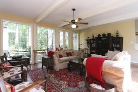 large family room with walls of glass allowing natural light to fill the room allowing natural light fill