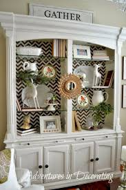 ideas china hutch decor pinterest: i could always paint china cabinet white and then tape paper on the inside so i can change easily whenever i get tired of it
