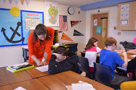 richard b cartmell elementary teacher working a student