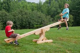 Image result for photo of kids on teeter totter