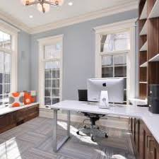chic contemporary home office with walnut storage cabinets blue home offices