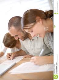 young students filling application forms stock photo image  young students filling application forms