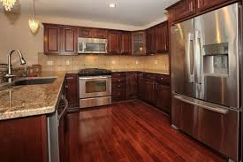 Wood Floor Kitchen White Kitchen Cabinets With Hardwood Flooring Stunning Home Design