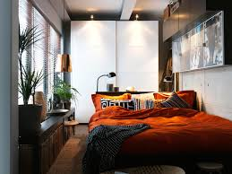 living room with bed: living room charming small room decor white painted closet cabinet deep orange bedding dark finished