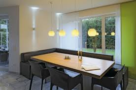image of modern pendant lighting over contemporary candle holders on rectangular dining table with outdoor living candle pendant lighting