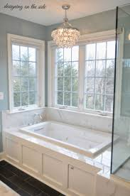 bathroom tub master bath marble tile sw rain crystal chandelier tile that looks lik