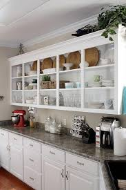kitchen features open shelving filled