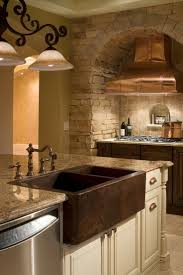 hammered copper kitchen sink: custom kitchen featuring copper range hood with hammered copper farm sink wwwimyourbuildercom