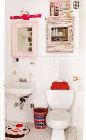 size bathroom wicker storage: small white bathroom with pink mirror frame containing reclaimed wood medicine storage with vibrant wicker trash bin also kid themed vanity rug plus wall