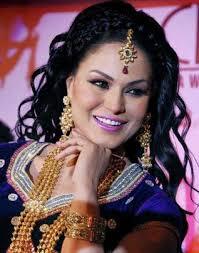 Pakistani actor Veena Malik tied the knot with businessman Asad Bashir Khan Khattak in Dubai on Wednesday, a media report said. - 26TH_VEENA_MALIK_1698134e