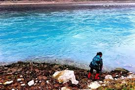 the colorful waters of china   offbeat chinafebury      a kid was playing at the polluted section of the wujiang river that ran through wujiang town  guizhou province