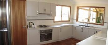 small u shaped kitchen design:  u shaped kitchen layout with island small with white wooden cabinetry with sink design
