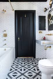 black white brass something retro in feel with white subway tile dark grout and brass plumbing fixtures then theres the very modern vanity light black white home office cococozy 5