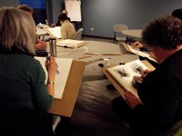 lydia sherman workshop participants figure out how to get an image on paper at a drawing