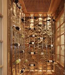 cool wine racks set against a stone backdrop give this cellar an artistic appeal cellar lighting