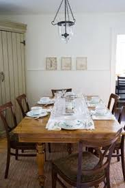 rustic dining room a french farmhouse inspired space for entertaining a chunky wood harvest casual dining room lighting