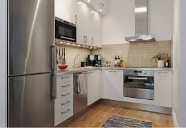 small space kitchen ideas: white or stainless steel appliances and white kitchen cabinets increase small kitchens visually
