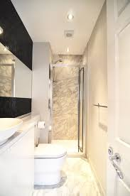 the spares were all extremely limited but the use of the marble and the black mosaic made the room have an instant wow factor i still love it to this day ample shower room