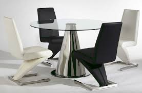 black kitchen dining sets: kitchen dining sets with rounded table made of glass with chrome metal leg also curved chairs in black and white made of faux leather and chrome metal leg