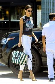 of kendall jenner s chicest looks white skinnies bags and pants kendall jenner picks up justin bieber at equinox gym in woodland hills california on