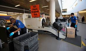 airport security  tag  pbs newshour transportation security administration tsa officers inspect luggage at los angeles international airport in los