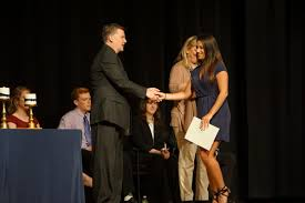 cardinal spellman inducts new national honor society members principal paul kelly congratulates senior allison keenan of holbrook on her re induction to the national honor society