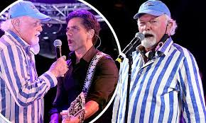 The <b>Beach Boys</b>' Mike Love rocks out with John Stamos during ...