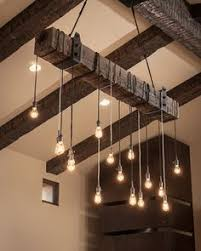 8 unusual light fixtures for those bored with chandeliers photos chandelier barn board