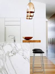 calacatta marble kitchen waterfall: a calacatta marble with a wide abstract pattern makes for an unexpectedly fresh complement to