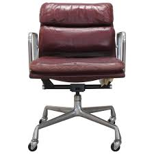 vintage cranberry leather soft pad chair by charles and ray eames charles and ray eames furniture
