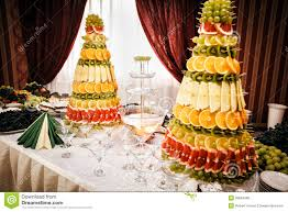 decor fountain decoration  champagne fountain and decorations from fruit on table setting a stoc